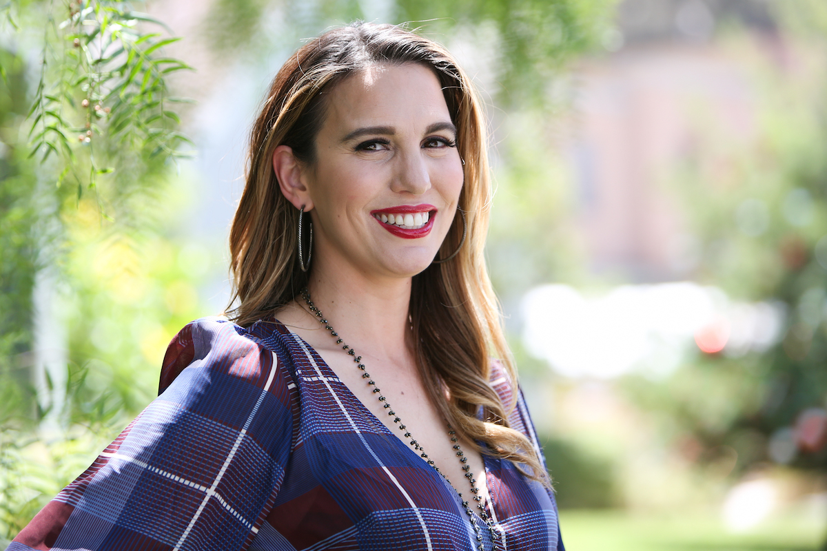 Christy Carlson Romano outdoors in plaid purple top