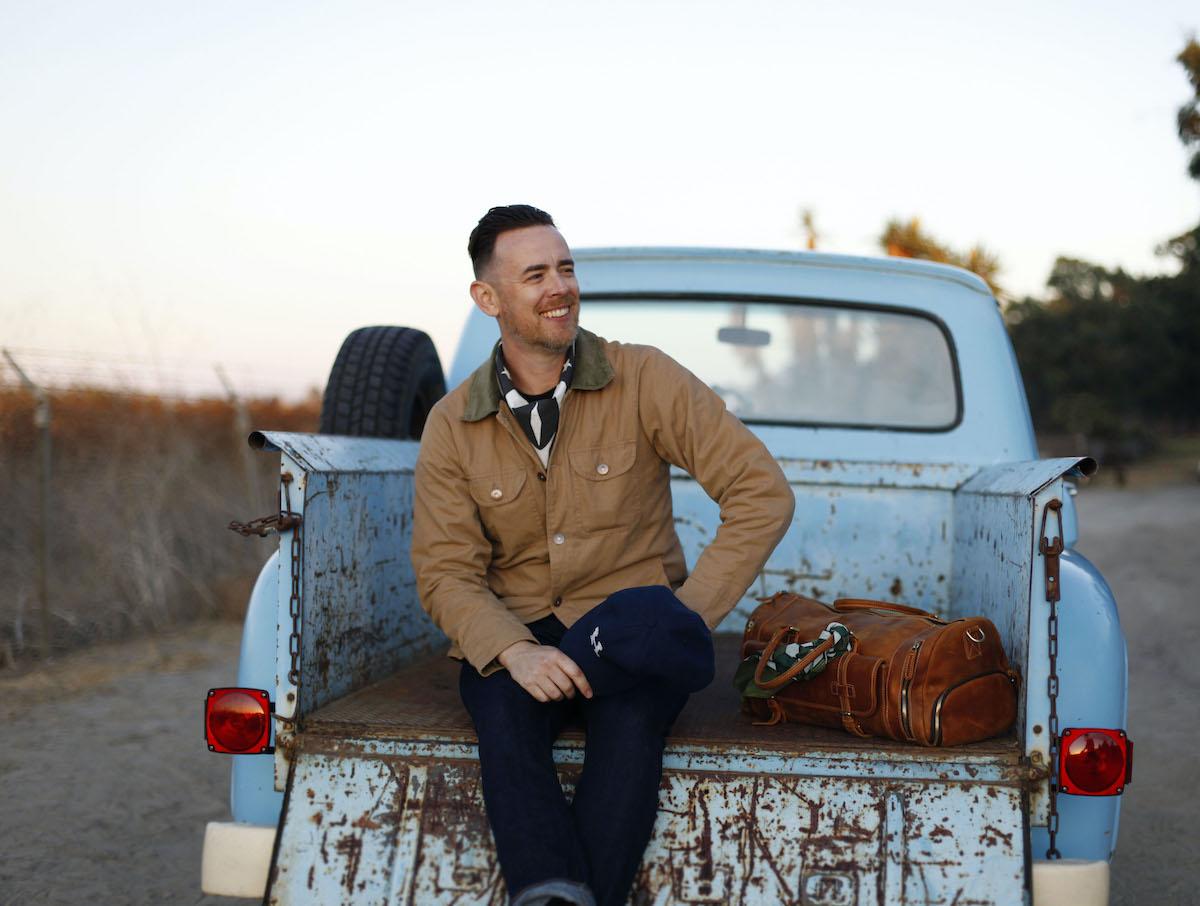 Colin Hanks on a pickup truck wearing Hanks Kerchiefs