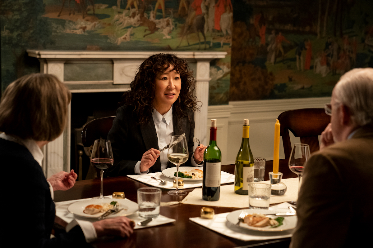 Cynthia Mace, Sandra Oh, and David Morse sit at a dining table in 'The Chair' Season 1