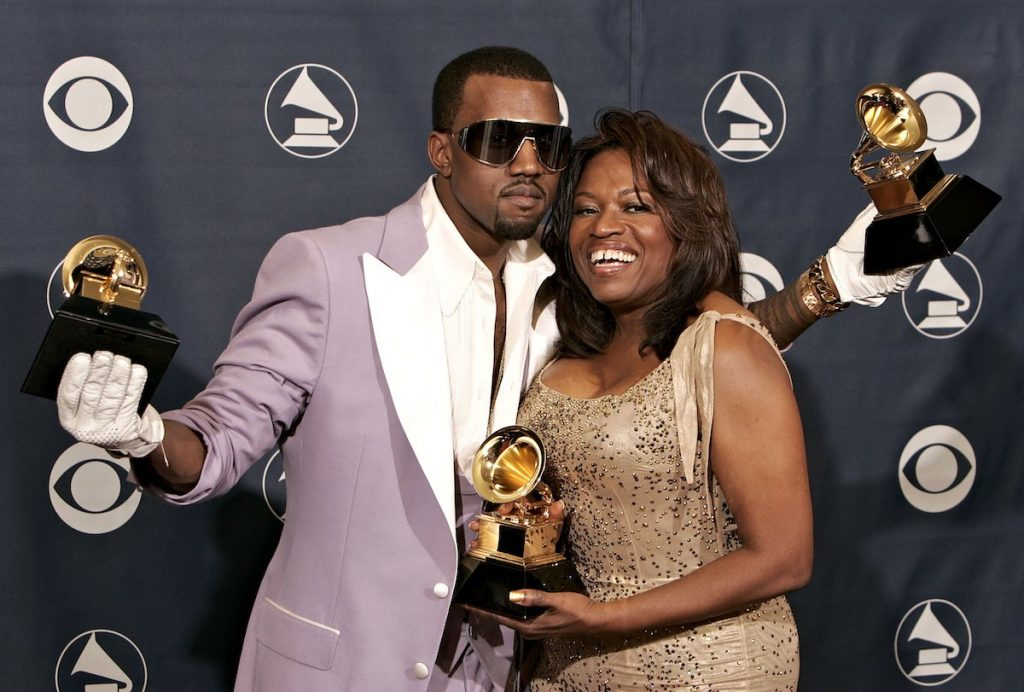 Singer Kanye West with his awards for Best Rap Song, Best Rap Solo Performance and Best Rap Album with his mother Donda West pose in the press room at the 48th Annual Grammy Awards at the Staples Center on February 8, 2006 in Los Angeles, California.