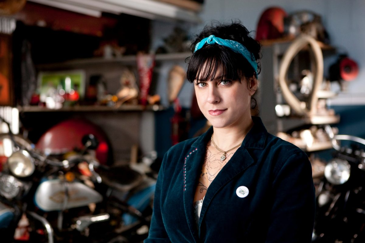 Danielle Colby with blue headband in her hair on 'American Pickers'