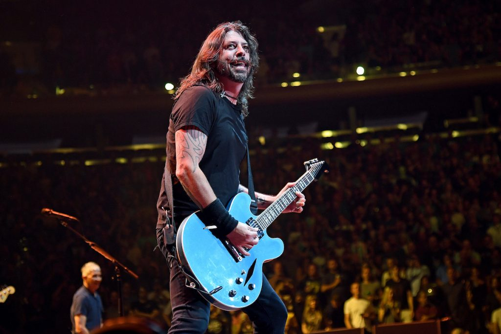 Dave Grohl playing guitar on stage.