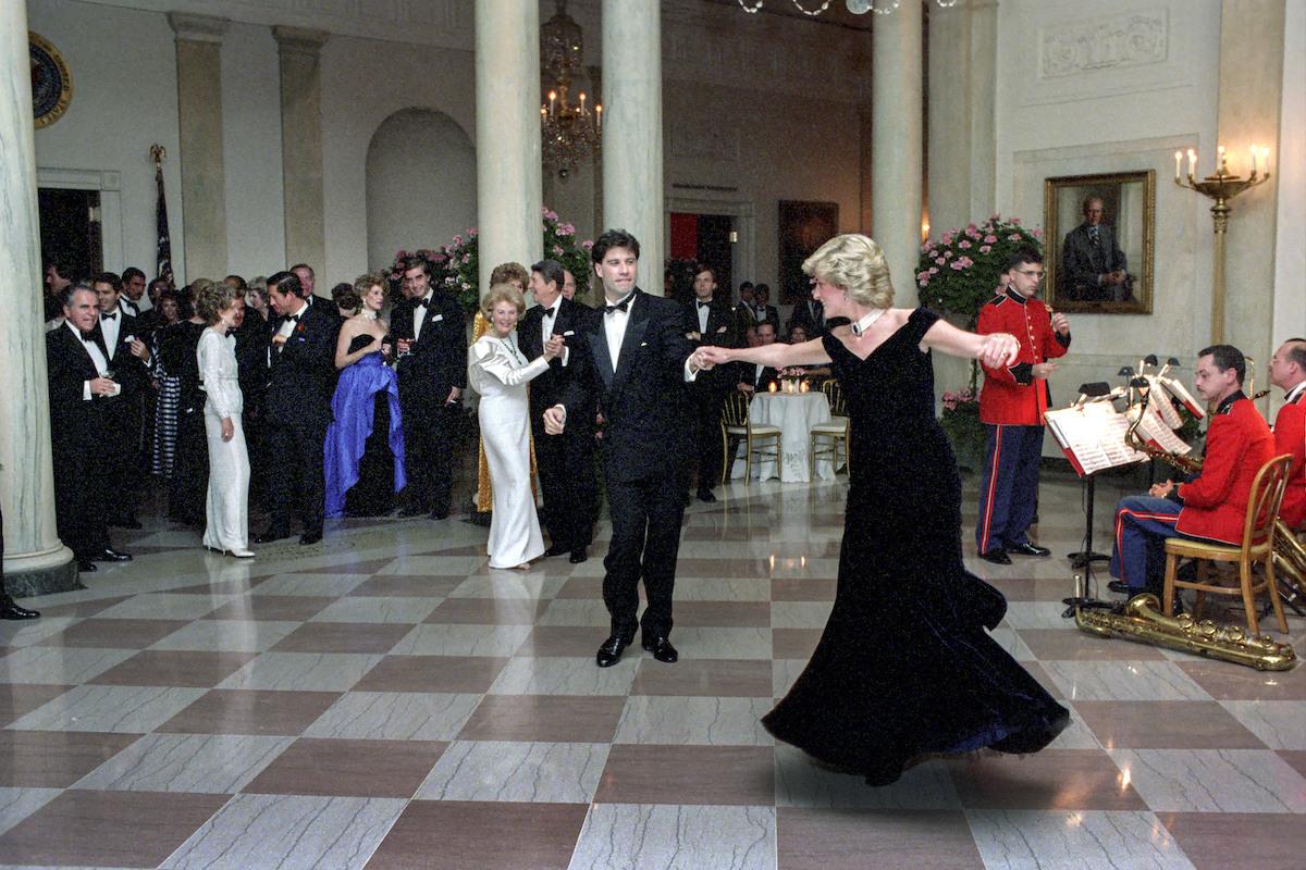 John Travolta and Princess Diana dancing in formal wear