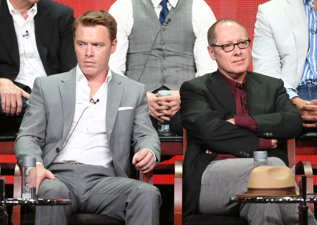 Diego Klattenhoff and James Spader sit next to each other during the TCA panel. Spader's arms are crossed.