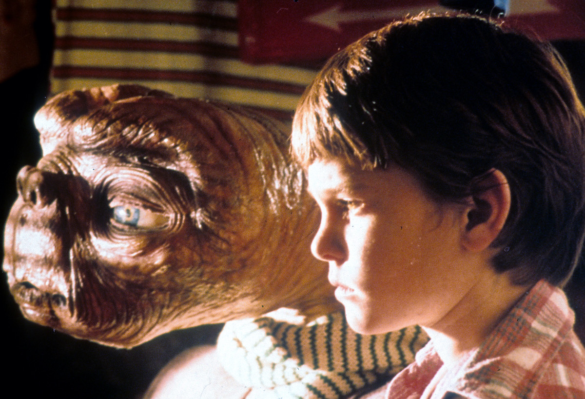 E.T. looking out the window with Henry Thomas in 'E.T. the Extra-Terrestrial'