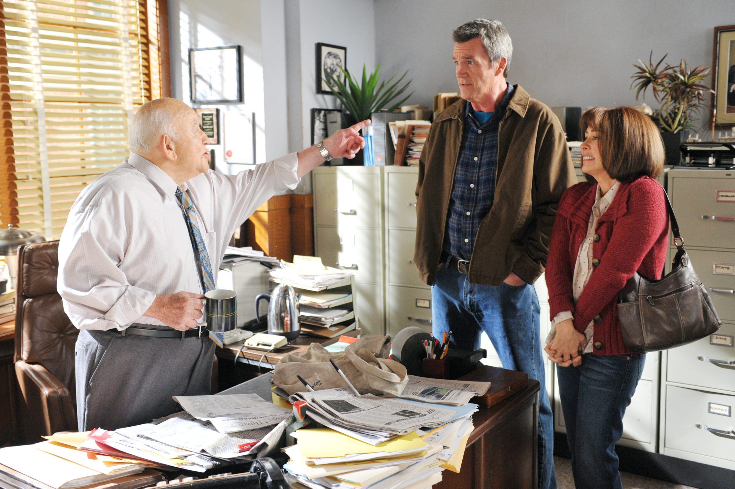 (left to right): Late actor Ed Asner in a scene from ABC's 'The Middle' with actors Neil Flynn and Patricia Heaton