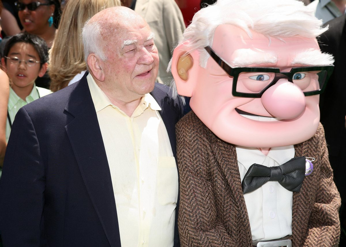 Ed Asner puts his arm around Carl from Up