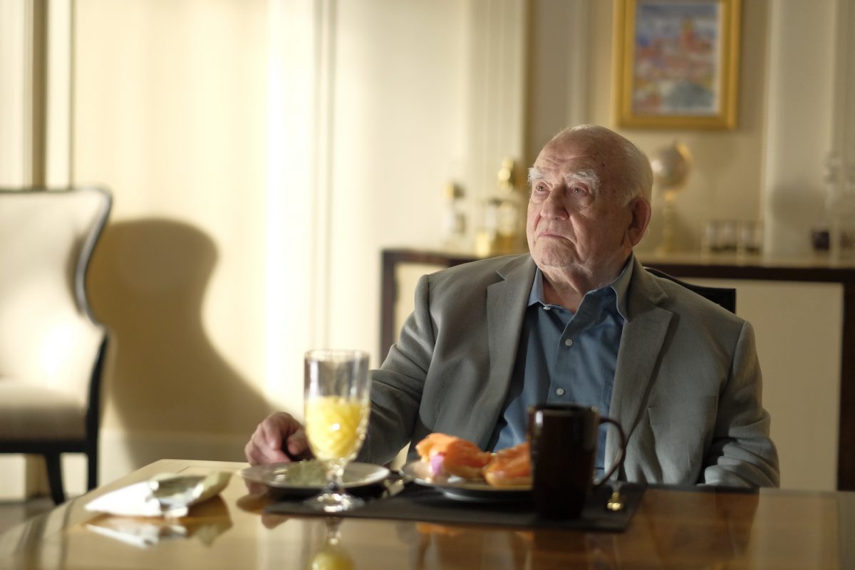 Ed Asner sits at his breakfast table on Cobra Kai
