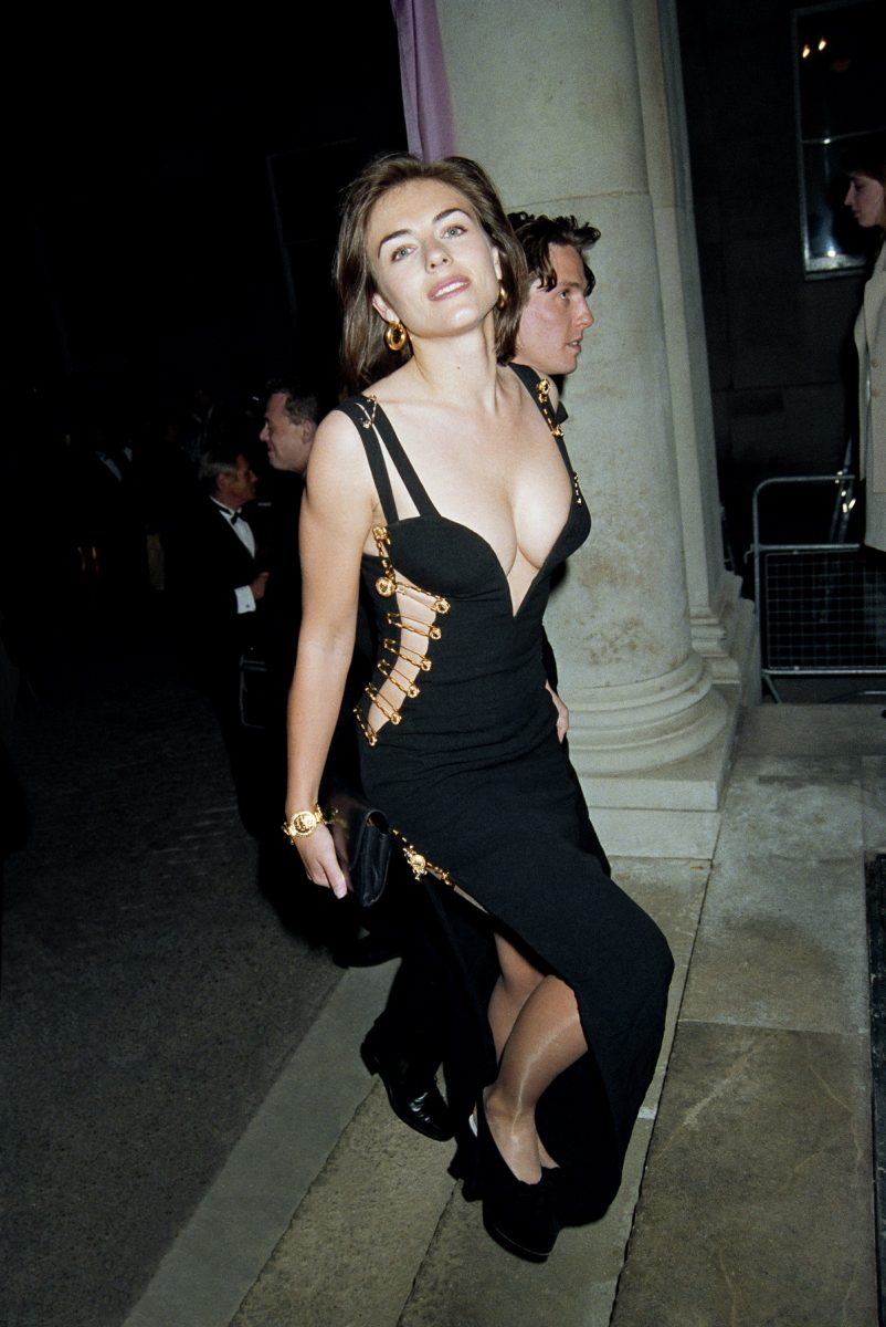 Elizabeth Hurley arriving with Hugh Grant to a party wearing famous safety pin dress in1994