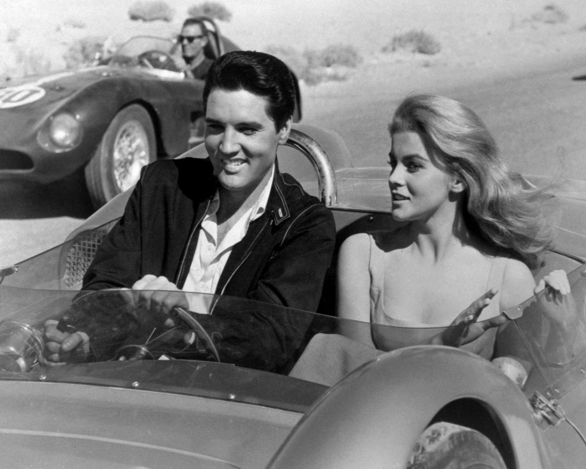 A black and white photo of Elvis Presley and Ann-Margret on the set of 'Viva Las Vegas'