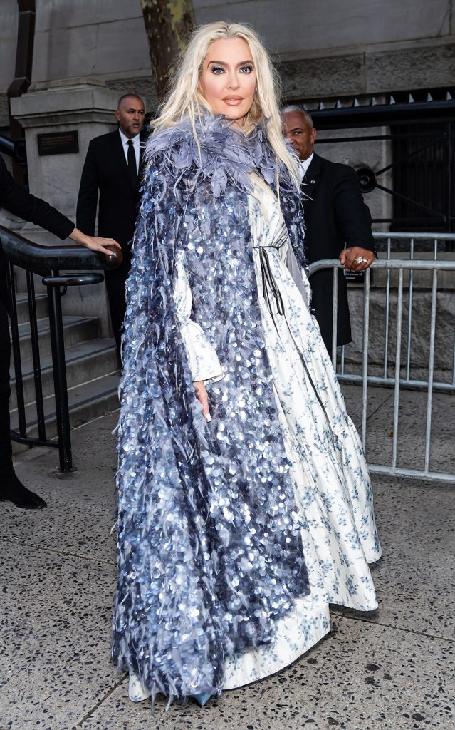 Erika Jayne twirls in a long, feathered cape.