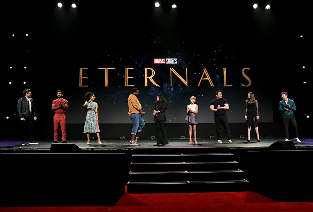 'The Eternals' cast standing side by side on stage at Disney's D23 EXPO in 2019