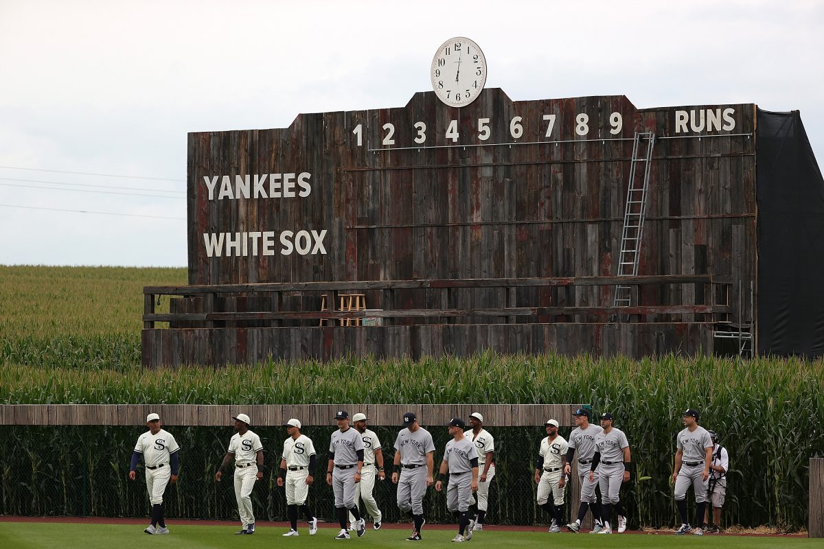Members of the Chicago White Sox and New York Yankees enter the field before a game at Field of Dreams