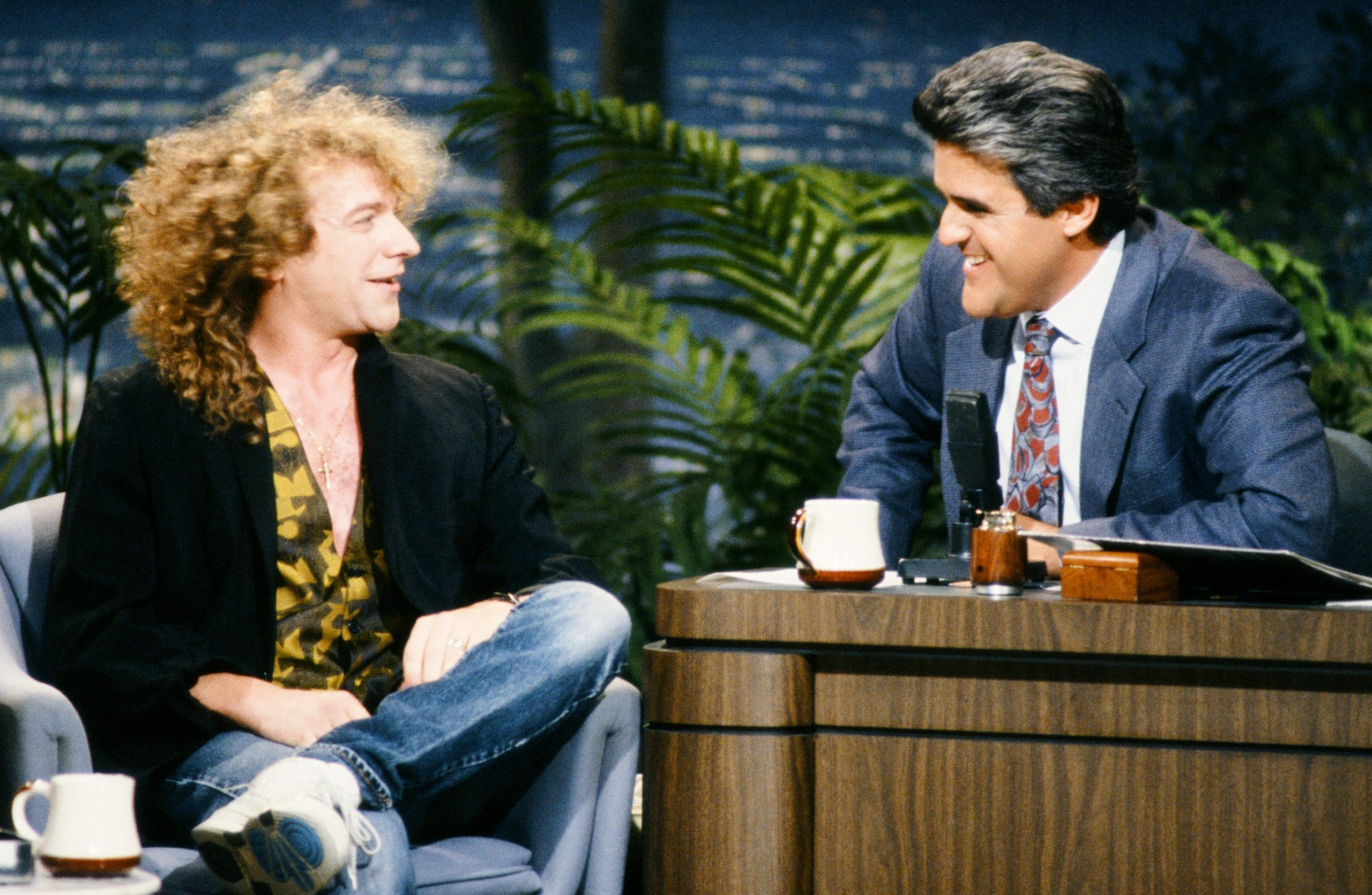 (left to right): Former Foreigner lead singer Lou Gramm, who gave 'Waiting For a Girl Like You' its soul, sat down with late-night show host Jay Leno in 1990