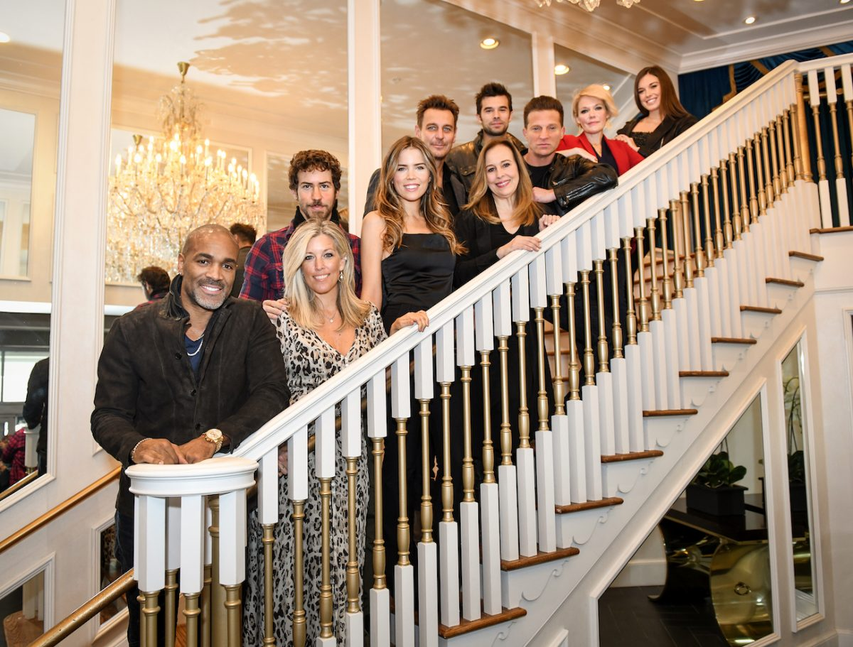 Cast members of 'General Hospital' standing on stairs