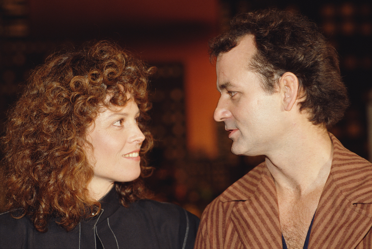 Bill Murray and Sigourney Weaver looking at one another at the 'Ghostbusters' premiere.