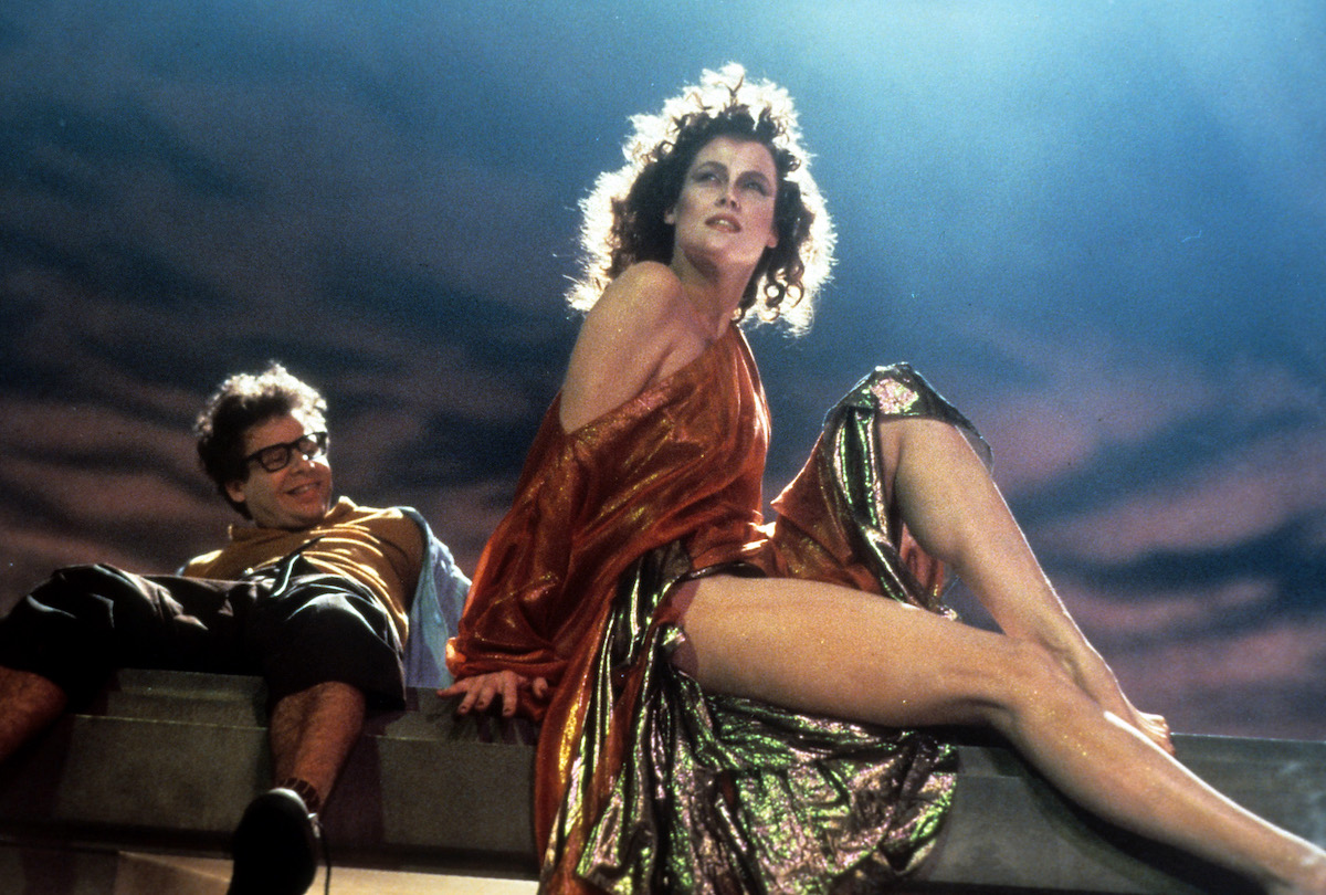 Rick Moranis looking up at Sigourney Weaver in a scene from the film 'Ghostbusters', 1984.