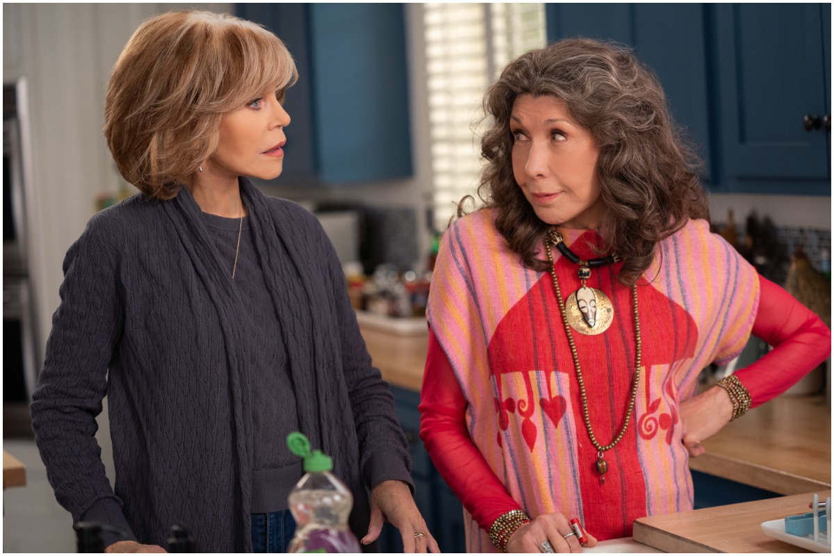 Grace wears a blue cardigan and Frankie wears a graphic tee on season 7 of 'Grace and Frankie