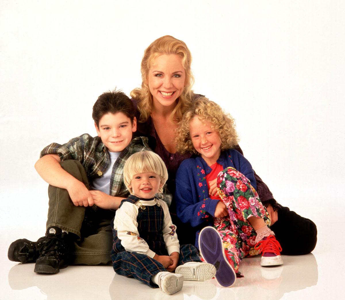 A group photo of the Grace Under Fire cast with white background