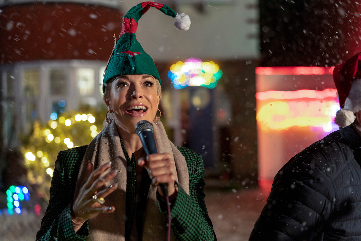 Hannah Waddingham wears an elf hat and sings into a mic in 'Ted Lasso' Season 2