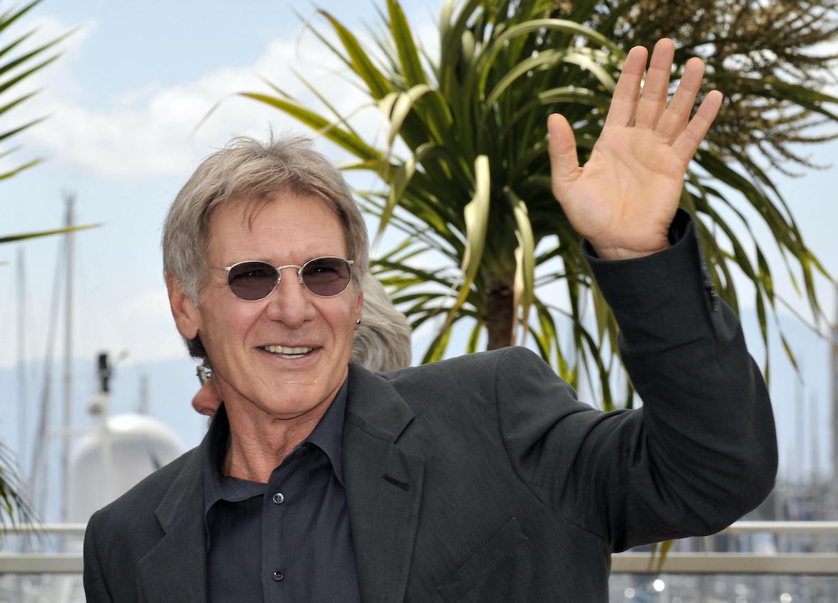 Harrison Ford waves and poses
