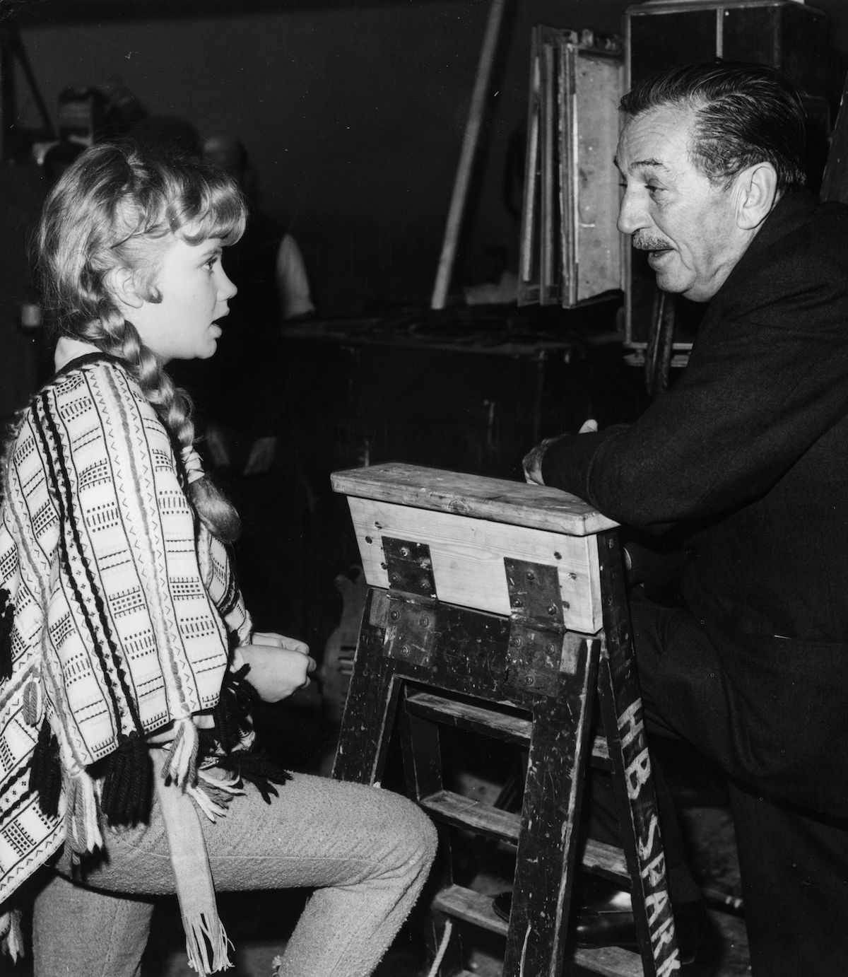 Hayley Mills and Walt Disney in a black and white photo