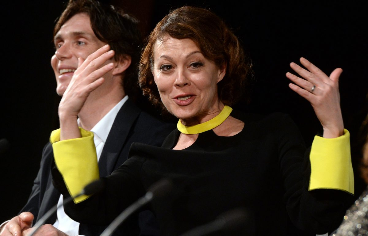Aunt Polly Gray actor Helen McCrory talking and holding her hands up with Thomas Shelby actor Cillian Murphy in the background of the 'Peaky Blinders' premiere
