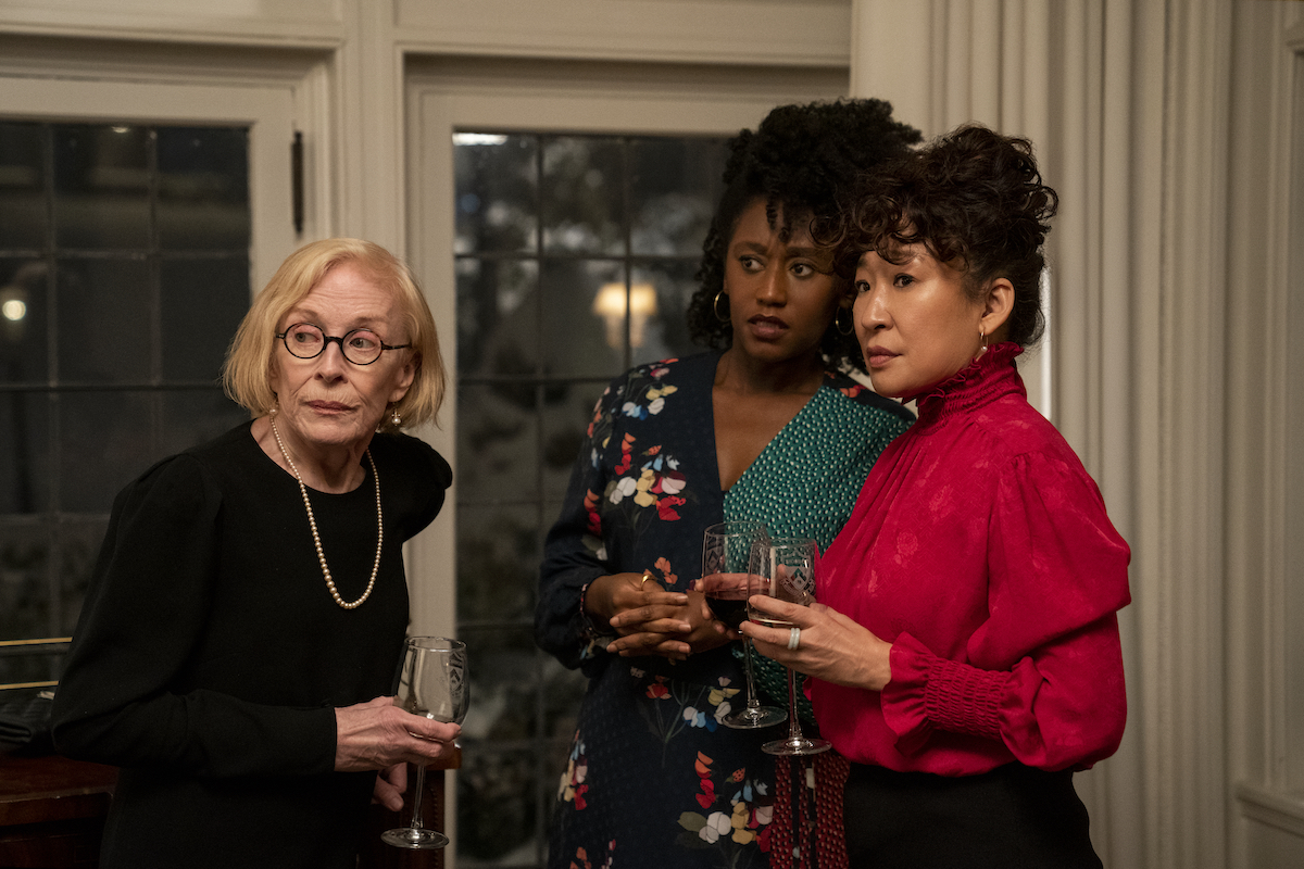Holland Taylor, Nana Mensah, and Sandra Oh stand together each holding a glass of wine in 'The Chair' Season 1