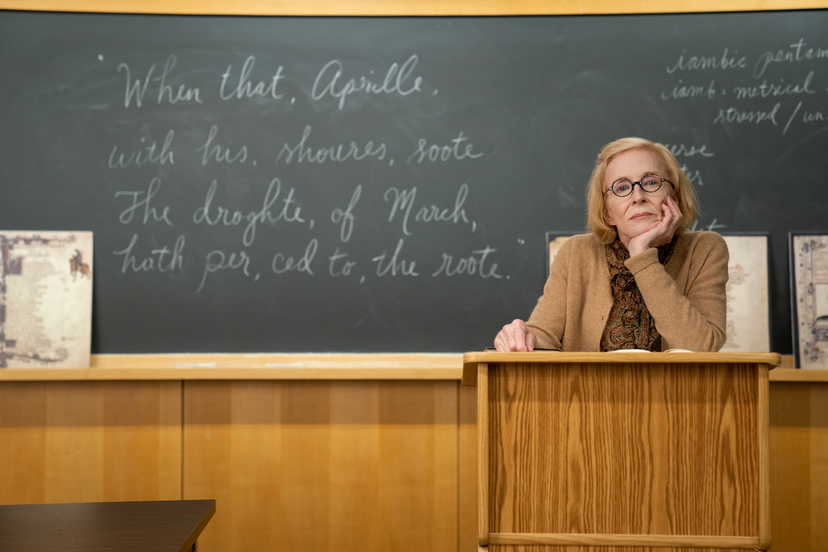 Holland Taylor stands behind a lectern with her chin resting in the palm of her hand as professor Joan Hambling in 'The Chair' Season 1