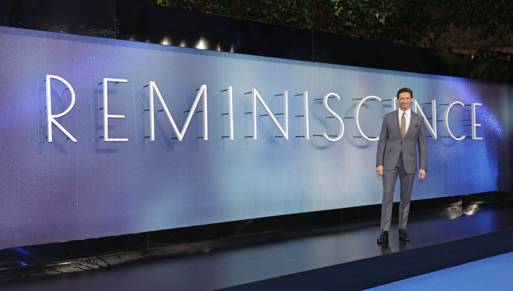 Hugh Jackman standing in front of Reminiscience sign