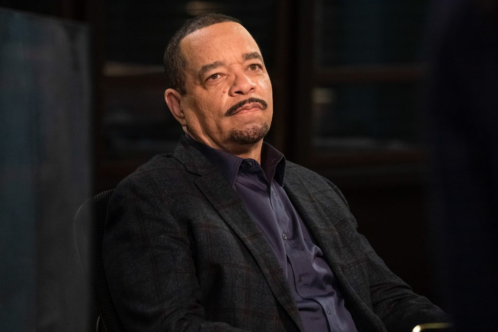 Ice-T sitting in a chair