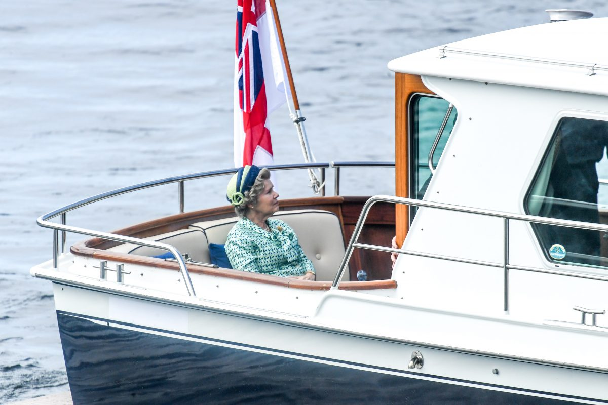Imelda Staunton who plays Queen Elizabeth II in 'The Crown' Season 5 seen on a boat made to look like a royal yacht