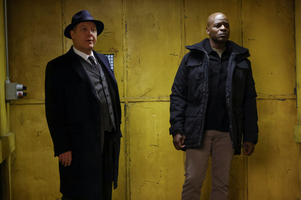 James Spader as Raymond 'Red' Reddington, Hisham Tawfiq as Dembe Zuma stand in front of a yellow background upon entering the task force location.