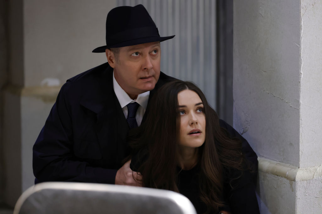 James Spader as Raymond 'Red' Reddington, Megan Boone as Liz Keen hide in the Latvia bunker while under fire.