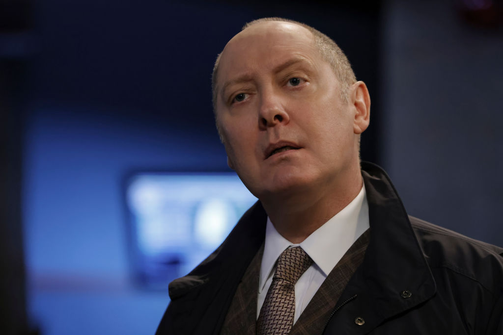 James Spader as Raymond 'Red' Reddington stands with a look of confusion on his face.