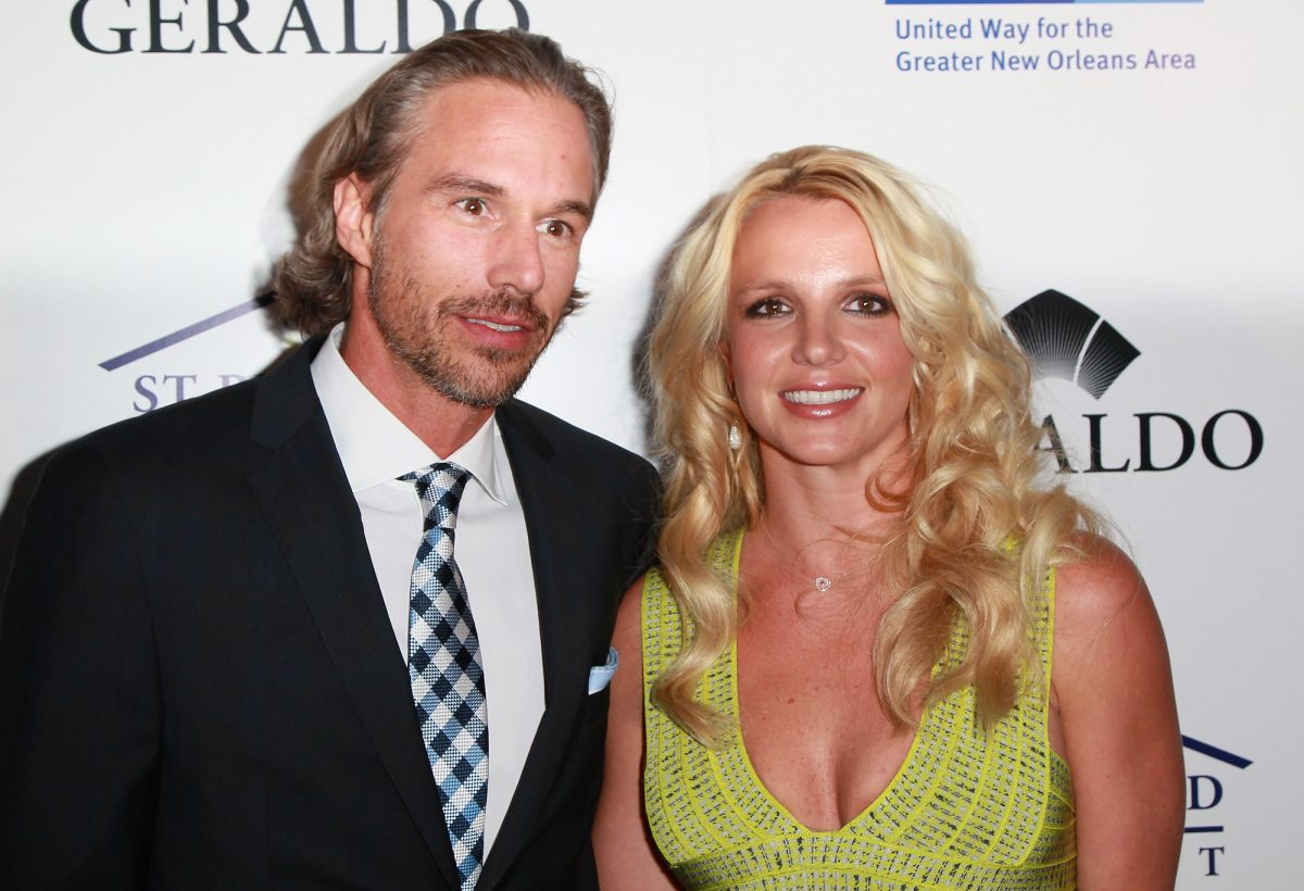 Britney Spears posing with her ex-fiancé Jason Trawick at an event in 2011