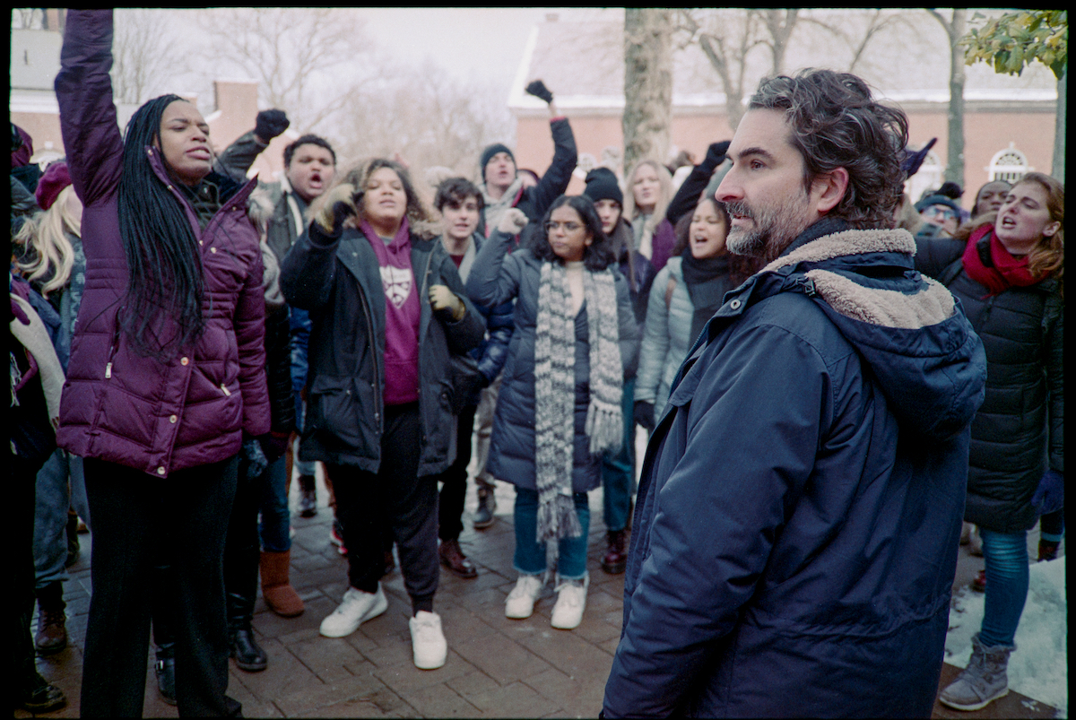 Jay Duplass wears a parka as he's surrounded by a crowd in 'The Chair' Season 1