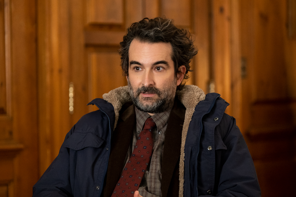 Jay Duplass wears a parka and sits in a chair as Bill Dobson in 'The Chair' Season 1 Episode 3