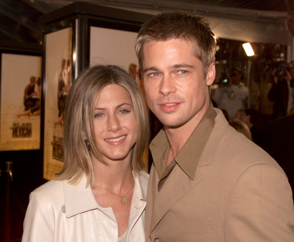 Brad Pitt and Jennifer Aniston pose together at the premiere of 'The Mexican' in 2001