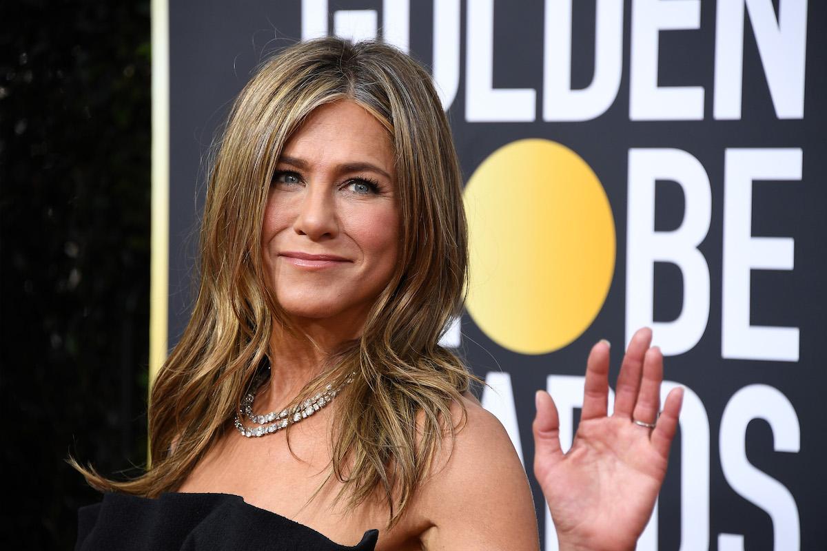 Jennifer Aniston waves in black dress