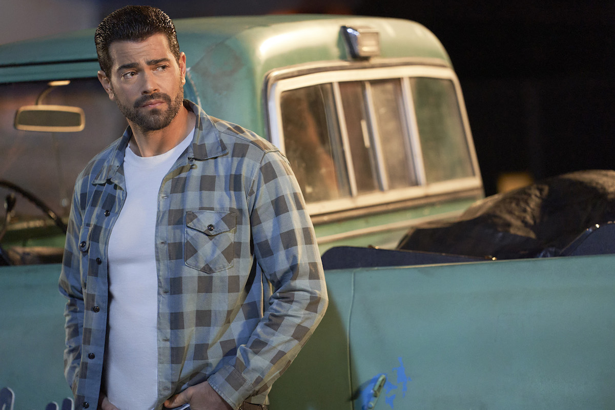 Trace (Jesse Metcalfe) leaning against truck in 'Chesapeake Shores'