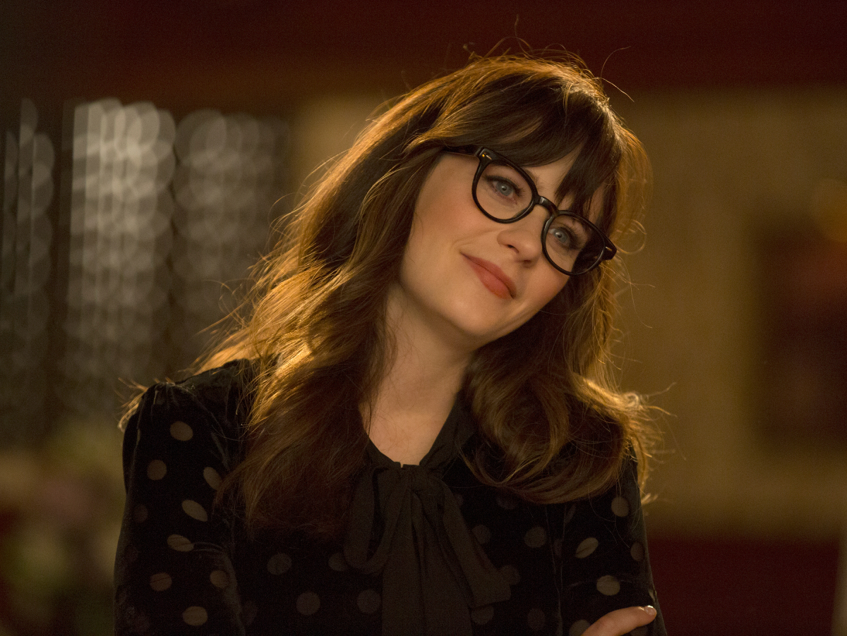 Zooey Deschanel as Jess from 'New Girl' smiling and wearing glasses