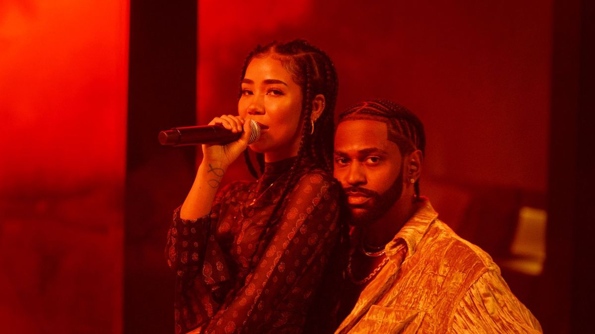 Jhené Aiko sits on Big Sean's lap as they perform a song at an award show