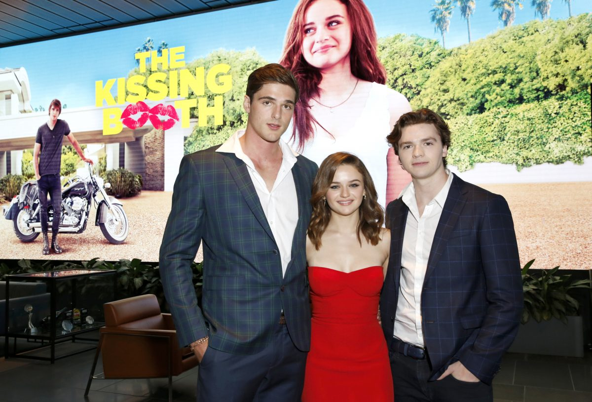 Jacob Elordi, Joel Courtney wearing suits and Joey King wearing red dress