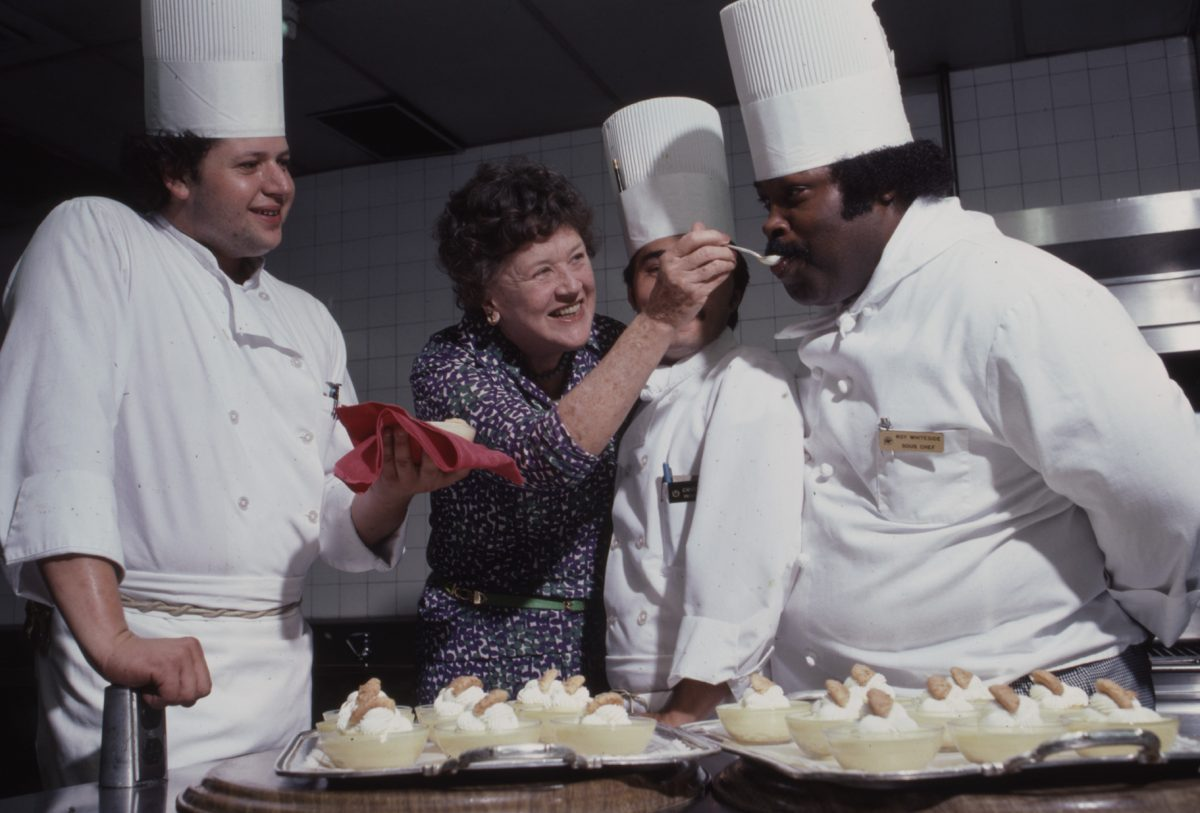 Julia Child is seen cooking with other chefs in 1979