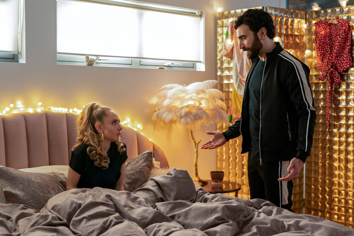 Brett Goldstein stands next Juno Temple while she lays in bed in 'Ted Lasso'