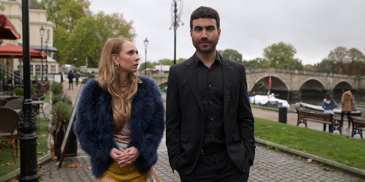 Juno Temple wearing a furry jacket and walking next to Brett Goldstein in a black suit in 'Ted Lasso' Season 1