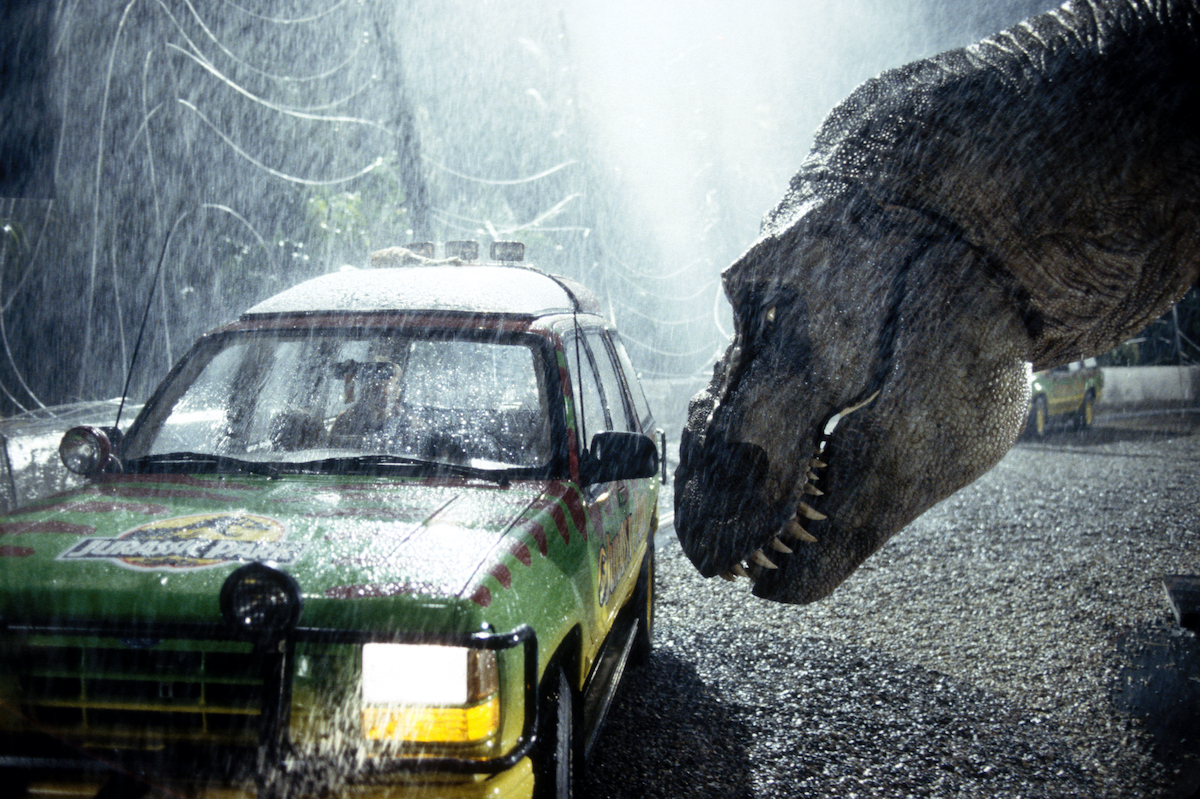 A Tyrannosaurus Rex terrorizes people trapped in a car from 'Jurassic Park'