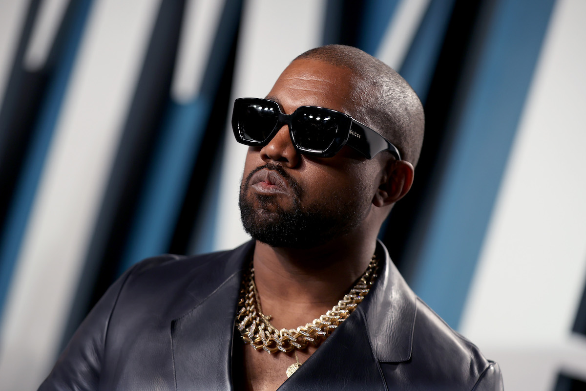 Kanye West wearing black shades and leather coat while attending the 2020 Vanity Fair Oscar Party hosted by Radhika Jones at Wallis Annenberg Center for the Performing Arts on February 09, 2020 in Beverly Hills, California.