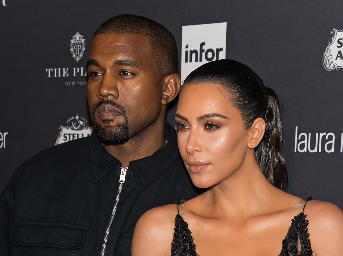 Kanye West and Kim Kardashian West posing on the red carpet at the Harper's Bazaar Celebrates 'ICONS By Carine Roitfeld' event in 2016